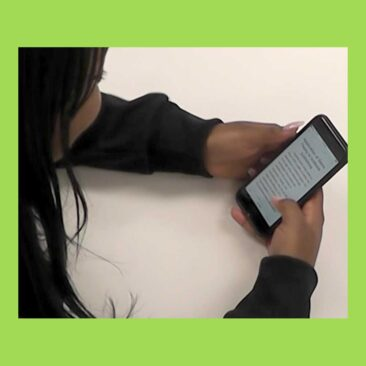 Photo of a college student interacting with an EPUB document on an iPhone.